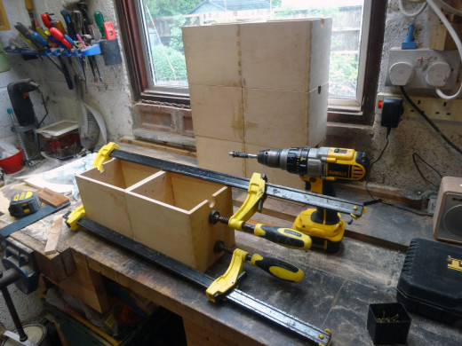 Leaving the pairs of drawers clamped up overnight for the glue to set.