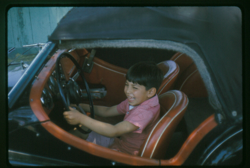 From the grin on his face you can tell that my middle son Mike also liked being behind the wheel of my TR-3.