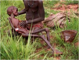 A mother in poor conditions looking at her dying child