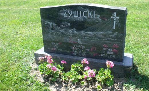 Tammy Jo Zywicki is buried at the West Newton Cemetery in West Newton, Pennsylvania.