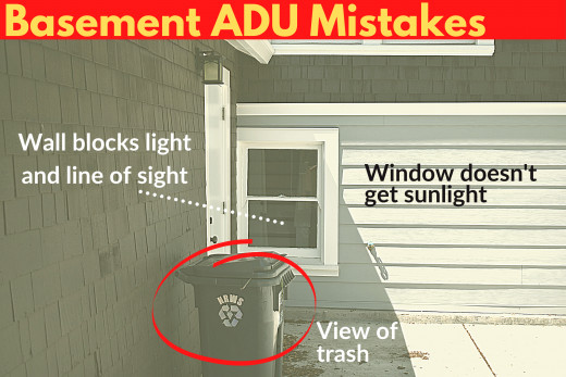 Basement ADU Mistakes - basement window that gets no light, has a blocked line of sight, and is right by the trash