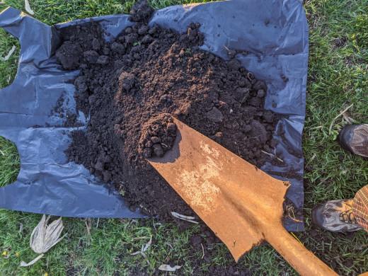 dirt on shovel, less as hole deepens