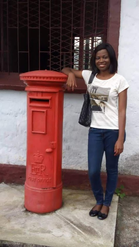 Posing before one of the oldest post offices in Cameroon