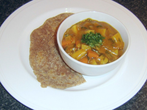Indian paratha with vegetable curry