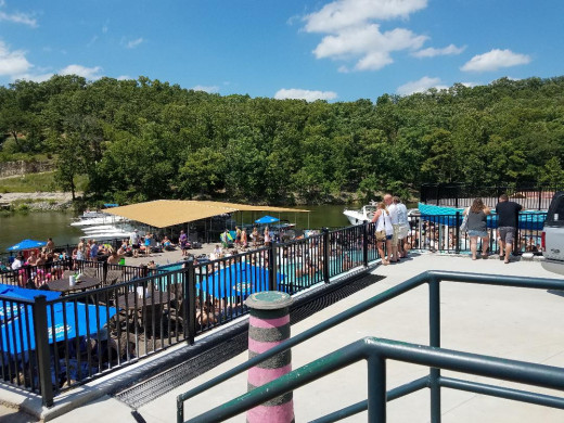 Backwater Jack's at Lake of the Ozarks. This is a cool place with indoor and outdoor restaurant seating, an indoor bar, and an outdoor pool with swim-up bar. People drive here by car or boat for good food, drinks, and fun.