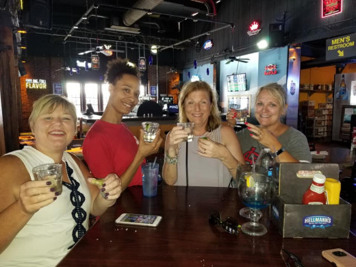 Friends and I enjoying a few drinks with the bartender at Big Daddy's on the Landing.