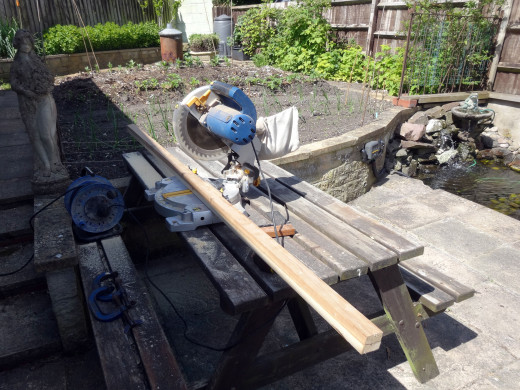 Using a mitre saw to cut the timber to lengths for making the front panel frame.