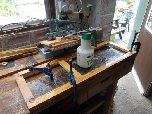 Assembled frame wetted down, clamped, and left overnight to encourage the warped wood back into shape.