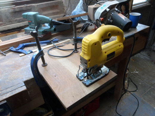 Using a jig saw to cut-out the shelves.