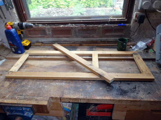 Off cut from original wood used to make the frame to be used to make the replacement middle rail.