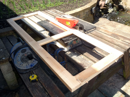 Using my bench saw to trim panel frame's styles for flush fit to display cabinet.