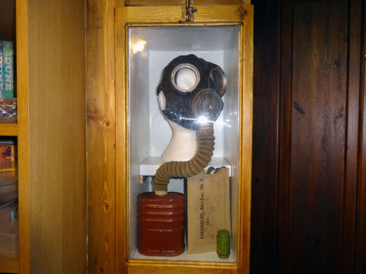 Other WWII artefacts also placed on display in the cabinet, including a pack of 'Eye shields, Anti-Gas, Mk II', and accompanying compound still in its green tube.