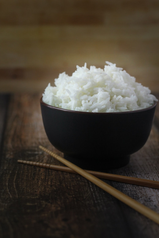 Amazing Cooked Rice with a Chopstick next to the bowl.