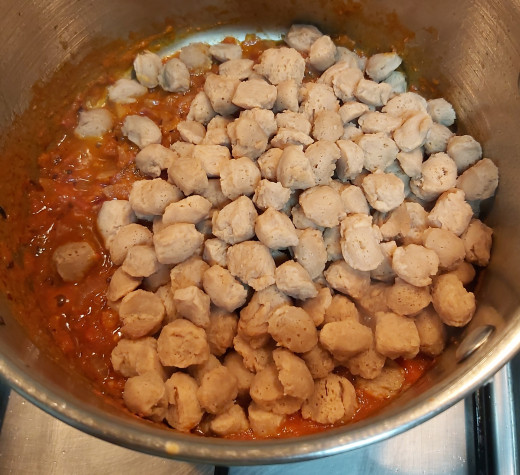 Add cooked and squeezed mini soya chunks or meal maker.