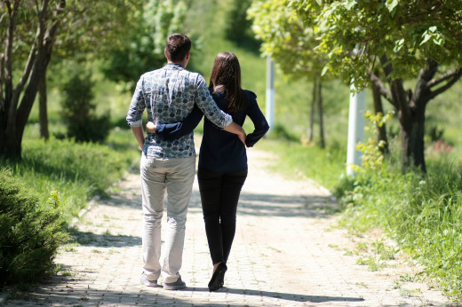 Couple having a cool walk in the garden