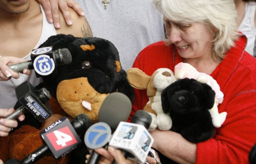 Holding Nevaeh's favorite stuffed animals, Sherry Buchanan tearfully pleads for her granddaughter's safe return. Photo courtesy of Toledo Blade.