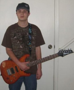Matthew Schulze and one of his electric guitars.