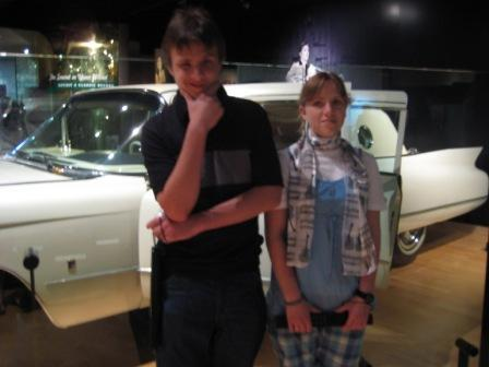 Me with my sister in front of Elvis' car. It is amazing.