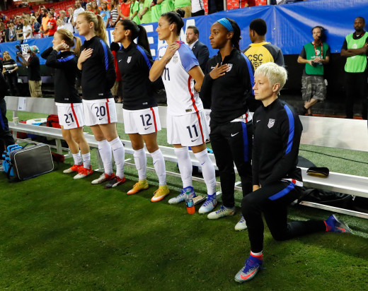 Megan Rapinoe With Similar Gesture As Kaepernick During The National Anthem