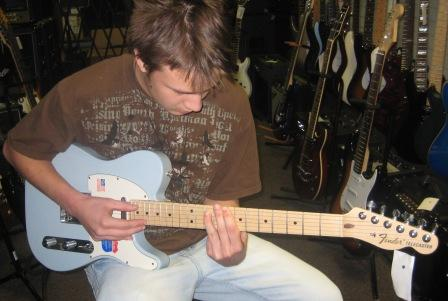 Matthew playing a Fender guitar. Fender is his favorite brand.