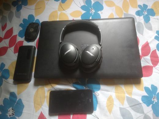 Laptop, headphones, Jio-Fi (mini router), power bank and smartphone