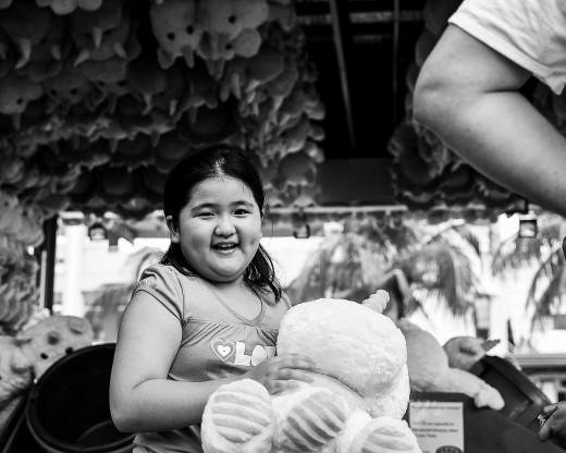 Little girl receiving a stuffed toy