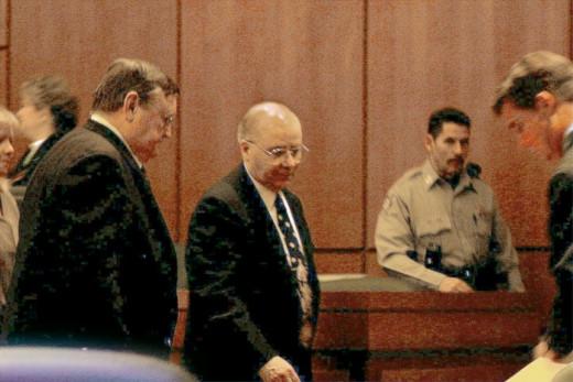 On October 13, 2003, John Edward Robinson, Sr., enters courtroom in Harrisonville, Missouri.