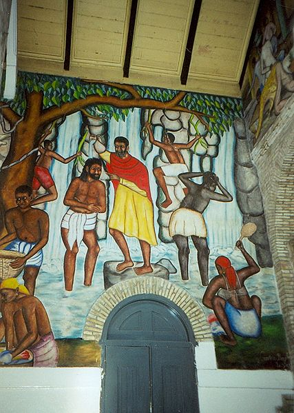 This is John the Baptist baptising Jesus as the Haitians imagine the event.  This is as good of a view as any.  Jesus was sinless, and did not need to be baptized.  He did it to be an example.