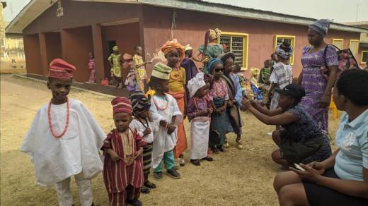 Nigerian Children putting on native dresses on Yoruba cultural day