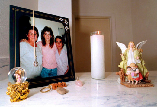 Tara's parents kept a candle lit since their daughter vanished in 1988. The photo shows Tara with her grandmother and brother, along with angels that Patty Doel collected.