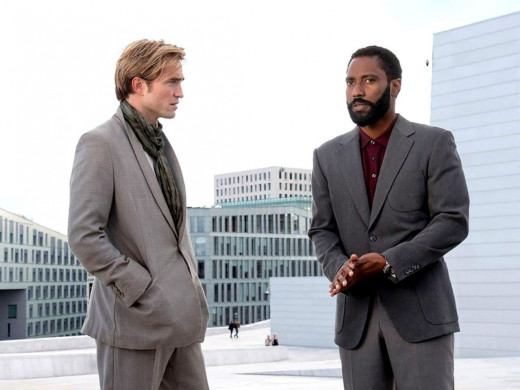 Two well-dressed men discussing stuff intensely? Yup, it's a Christopher Nolan movie.