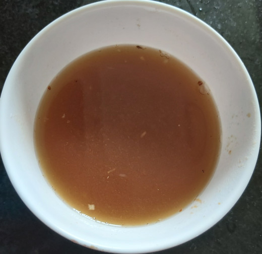 Once the tamarind pulp is soft, squeeze the juice and discard the fiber. Keep tamarind juice aside.
