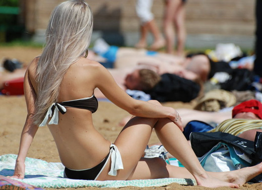 The production of Vitamin D to strengthen the immune system is one benefit of sunbathing, especially among lighter skinned people.