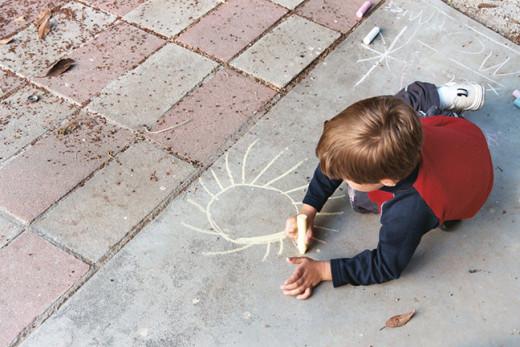 My grandson decorating my sidewalk for free.