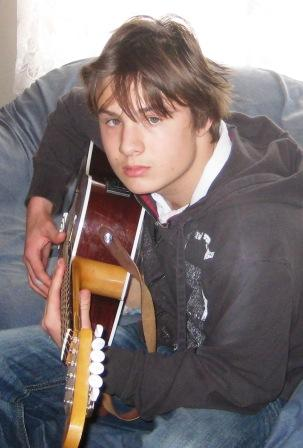 Matthew playing his electric acoustic guitar