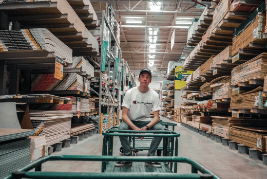 Man working in the lumber department of a large box store.