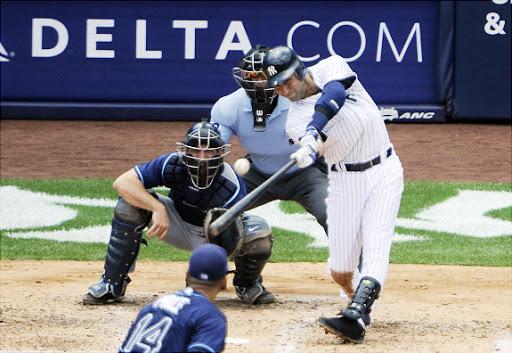 Derek Jeter, hitting a home run for his 3,000th hit.