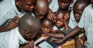 Kids mesmerized by a Kindle
