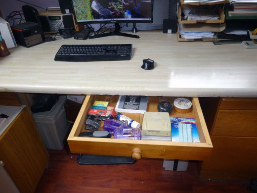 Stationery drawer under desk, repurposed from redundant pine dining table.