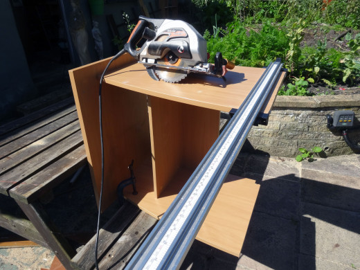 Marking up to cut an inch off the base of the unit, so that it will fit under the main desk.