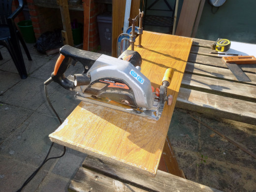 Using a circular saw to the cut the shelving to length.