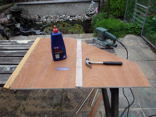 Rounding all the edges and corners with an electric sander.