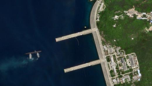 Satellite photo of submarine entering pen