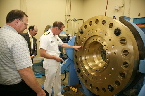 Honeywell Aerospace in Phoenix, where U.S. Navy personnel inspect a rocket engine.