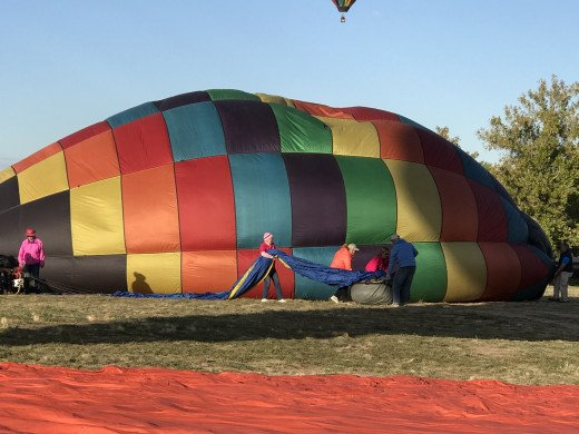 After the flight, a hot air balloon must be deflated and made ready for transport.