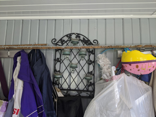 Initially, I hung the strips of trim on some coat hooks, but banging later made them fall into my head. Needed a hardhat.