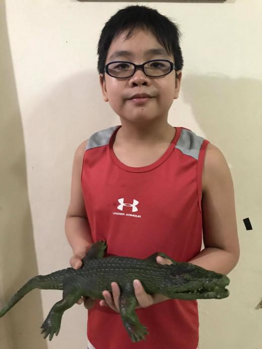 Leighton with his Alligator Toy