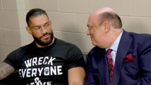 Paul discussing the contract signing with Roman in the locker room.