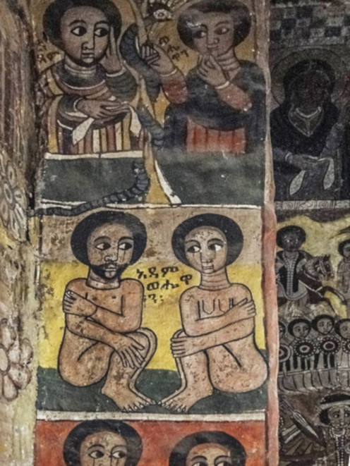 Painting of Adam and Eve inside Abreha and Atsbeha Church, Ethiopia. The Christian Bible says Adam and Eve  were tempted into disobedience in the Garden of Eden.