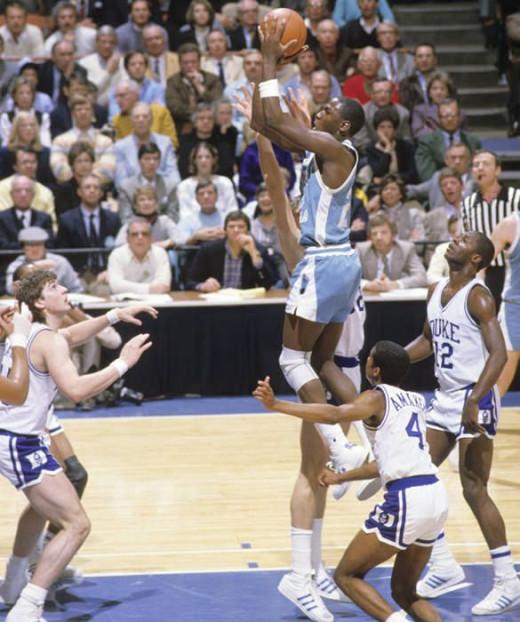 Michael Jordan (Center) going up for a layup.